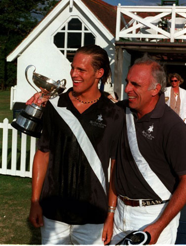Morrison, right, with his son Jamie after a polo tournament, was the oldest man to play for Britain